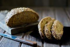 Freshly baked multigrain bread. On rustic background Stock Photography