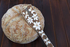 Organic bread and with various seeds strewn ladle Stock Photo