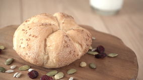 Freshly baked pastry rotating on a wooden board. Seamless loopable. stock video