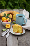 Freshly baked peach cake with tea Royalty Free Stock Images