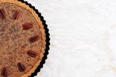 Freshly baked pecan pie in the baking tin Royalty Free Stock Photos