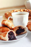 Freshly baked pie with jam. Bakery. Freshly baked pie with jam and cup of black tea Stock Photo