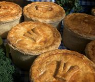Freshly baked pies. On sale at a London market Stock Image