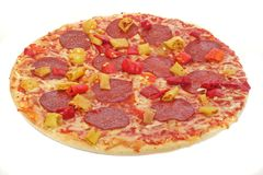 Freshly-baked pizza. A freshly-baked pizza with paprika, chili and salami isolated on white stock photography