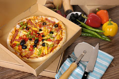 Freshly baked Pizza in delivery box with ingredients. Royalty Free Stock Image