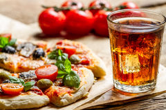 Freshly baked pizza and served with cold drink Royalty Free Stock Images
