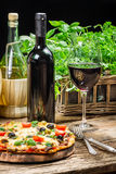 Freshly baked pizza served with red wine Royalty Free Stock Image