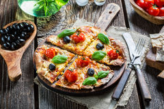 Freshly baked pizza split and given on baking paper Royalty Free Stock Photos