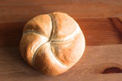 Freshly baked poppy-seed kaiser bun. Bakery products on wooden table. Concept of fresh pastry stock images