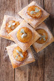 Freshly baked puff pastry pies with pineapple close-up. vertical Royalty Free Stock Photos