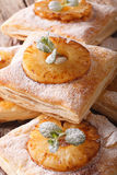 Freshly baked puff pastry pies with pineapple macro. vertical Stock Images