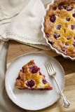 Freshly baked raspberry clafoutis. With sprinkle of icing sugar Royalty Free Stock Images