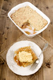Freshly baked rhubarb crumble with custard Stock Images