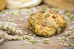Freshly baked roll with pumpkin seeds Royalty Free Stock Photography