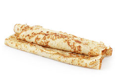 Freshly baked rolled blinis or crepes isolated Stock Images