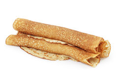 Freshly baked rolled blinis or crepes isolated Stock Photo