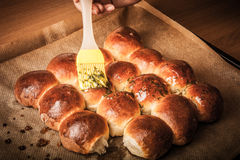 Freshly baked rolls smeared garlic butter and dill. Tinted Royalty Free Stock Photos