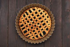 Freshly baked round homemade lattice blueberry pie in baking dish Stock Photos