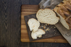 Freshly baked rustic loaf of bread in farmhouse setting with woo Stock Photography
