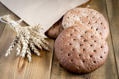 Freshly baked rye bread on wooden table Tasty bread Stock Photography