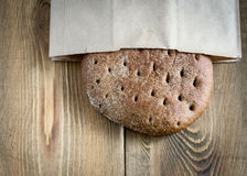 Freshly baked rye bread on wooden table Stock Photo