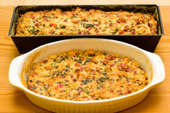 Salty cake in baking pan. Freshly baked salty cake in baking pan on wooden board Stock Photos