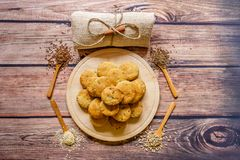 Freshly baked scones on a wooden plate with different  spices on Royalty Free Stock Photo