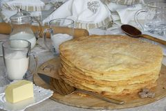 Freshly baked shortcakes for Napoleon cake and some ingredients. Royalty Free Stock Images