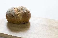 Freshly baked sliced bread on rustic wooden. Table Royalty Free Stock Images