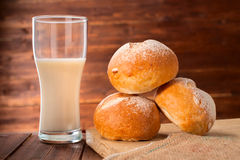 Freshly baked sliced buns and glass of milk Stock Photo