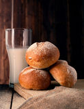 Freshly baked sliced buns and glass of milk Royalty Free Stock Photo