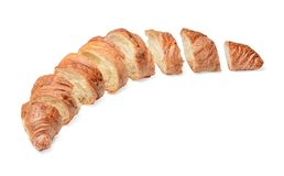 Freshly baked sliced croissant on white isolated background. Top side view. stock photo