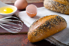 Freshly baked small breads with sesame and poppy seeds Stock Photos