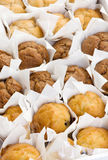 Freshly baked small muffins cakes in rows Stock Photos