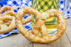Freshly baked soft pretzels sprinkling with coarse salt Royalty Free Stock Images