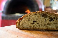 Freshly baked sourdough bread baked in a pizza oven royalty free stock photography