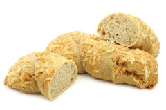 Freshly baked spelt bread covered with grated cheese Stock Photography