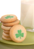 Freshly baked St. Patrick's Day sugar cookies. With a glass of milk Stock Photo