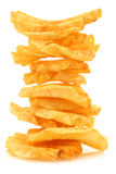 Freshly baked stack of deep ridged potato chips. On a white background Stock Image