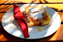 Freshly baked strudel with cheese sprinkled with cocoa and sugar Royalty Free Stock Image