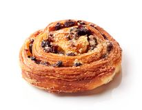 Sweet bun with raisins isolated on white royalty free stock image