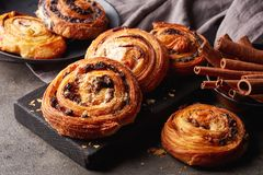 Sweet buns on black board isolated on stone table royalty free stock image