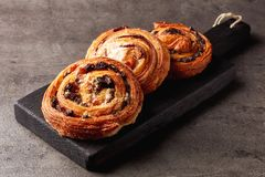 Sweet buns on black board isolated on stone table royalty free stock photos