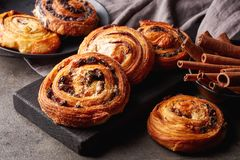 Sweet buns on black board isolated on stone table stock photography