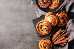 Sweet buns on black board isolated on stone table, from above royalty free stock photos