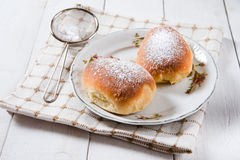Freshly baked sweet buns with jam Stock Images