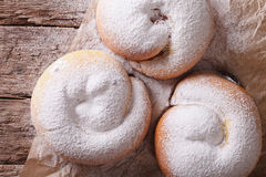 Freshly baked sweet rolls ensaimadas close-up on the table. hori Royalty Free Stock Image