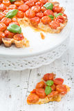 Freshly baked tart with cherry tomatoes on white Royalty Free Stock Photos
