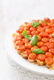 Freshly baked tart with cherry tomatoes on white Royalty Free Stock Image
