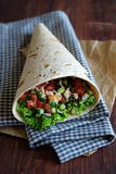 Freshly baked tortilla wrap with cucumbers Royalty Free Stock Images